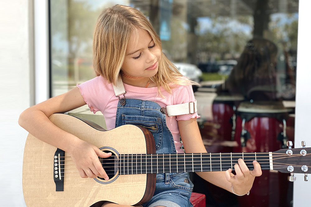 cayman girl guitar lessons music school kids